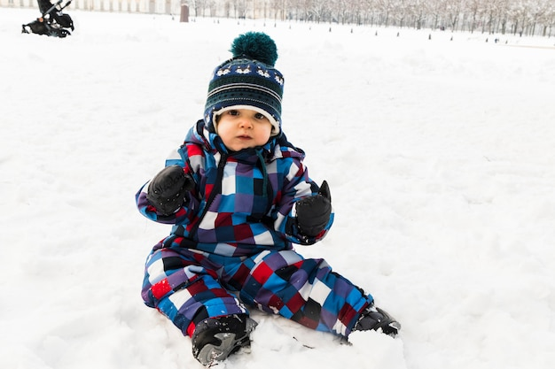 Baby on snow in the forest