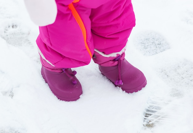Baby snowboots in the fresh snow