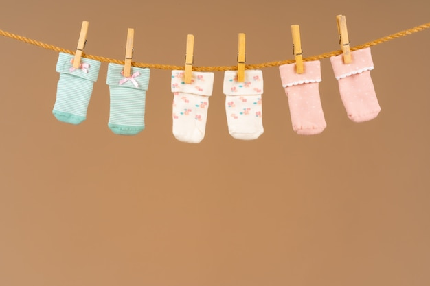 Baby socks on a clothesline. baby clothes washing