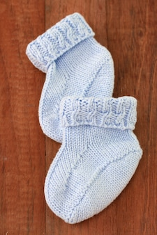 Baby socks on dark surface