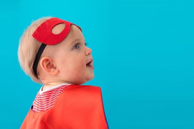 Baby superhero looking away