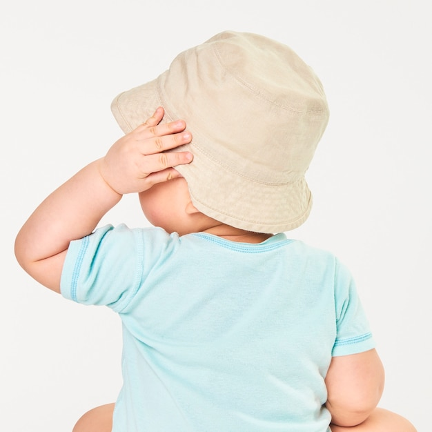 Baby wearing beige bucket hat