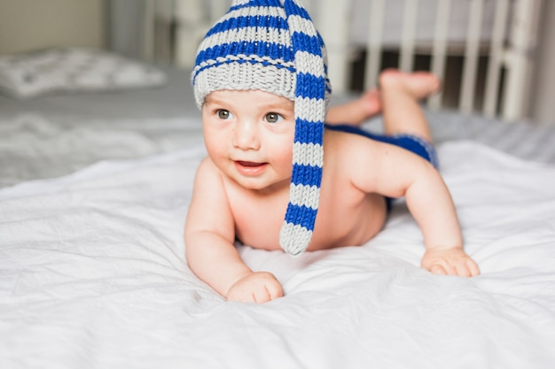 Baby wearing striped knitted hat
