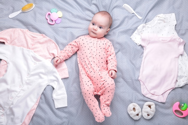 Baby on white  with clothing, toiletries, toys and health care accessories. wish list or shopping overview for pregnancy and baby shower.