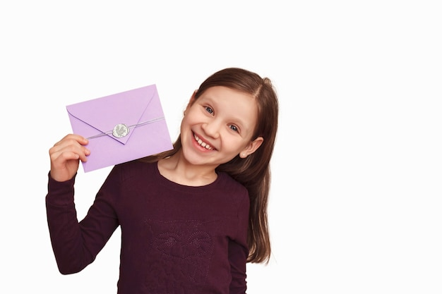 Baby with a gift envelope on a white background