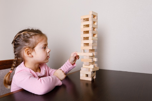 Baby with mom playing in wooden blocks