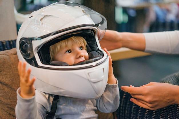 Baby with a motorbike helmet