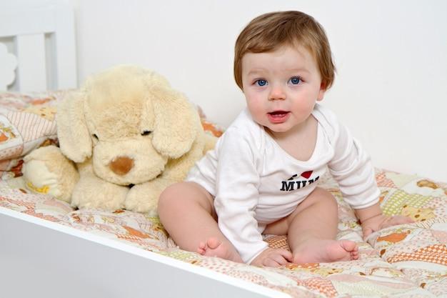 Baby with plush dog
