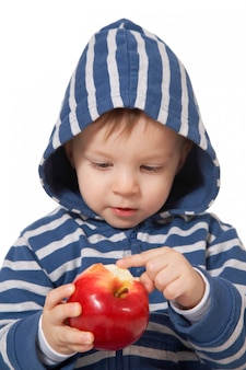 Baby with red apple