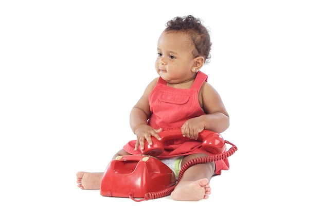 Baby with red phone a over white background