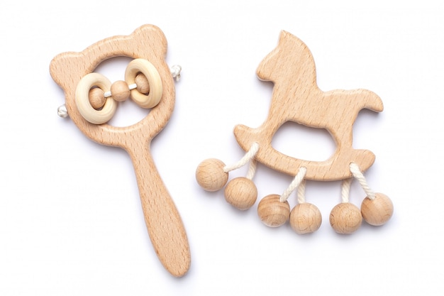 Baby wooden rattles and toys on white