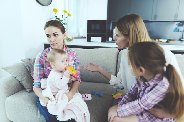 Babysitter talk with the mother of children