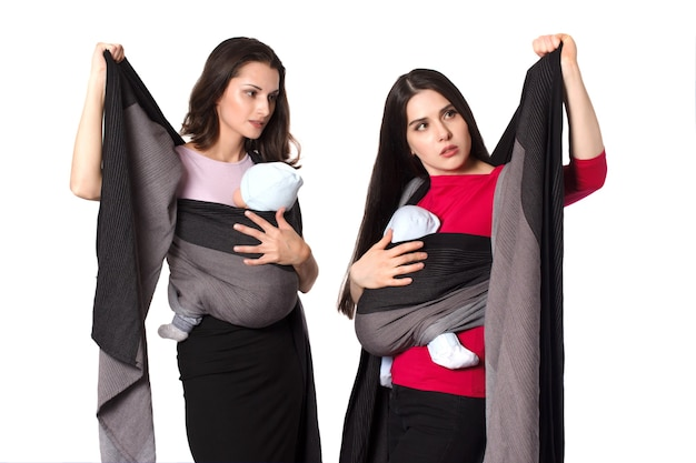 Babywearing instructor educate young mother how to use a woven wrap baby carrier and tight front wrap cross carry