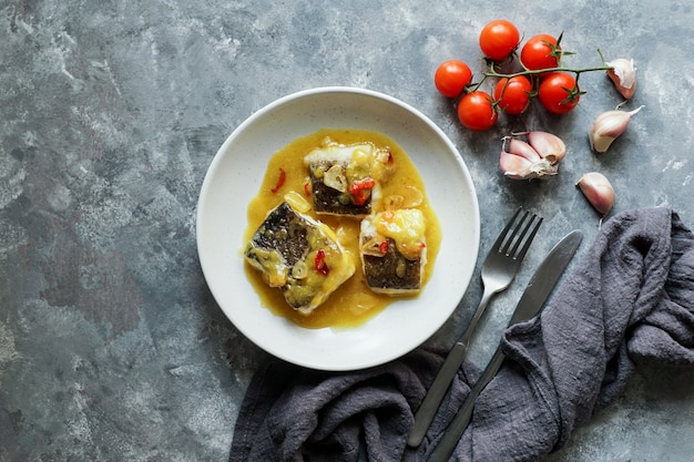 Bacalao al pil pil, salted cod in emulsified olive oil sauce