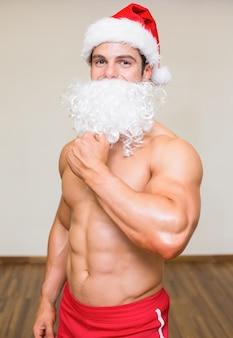 Bacho man with fake santa beard at the gym