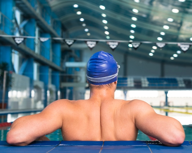 Back of athletic male swimmer