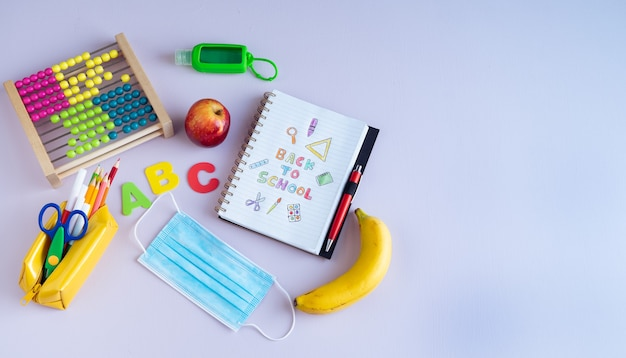 Back to class. notebook with text and various complements. copy space.
