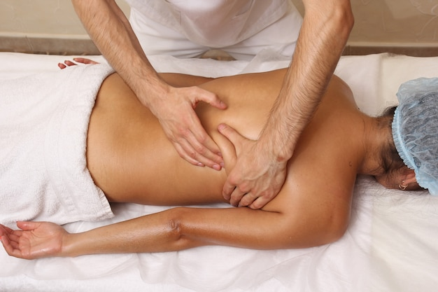 Back massage in the spa salon.