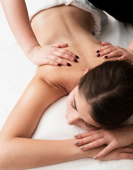 Back massage technique at spa