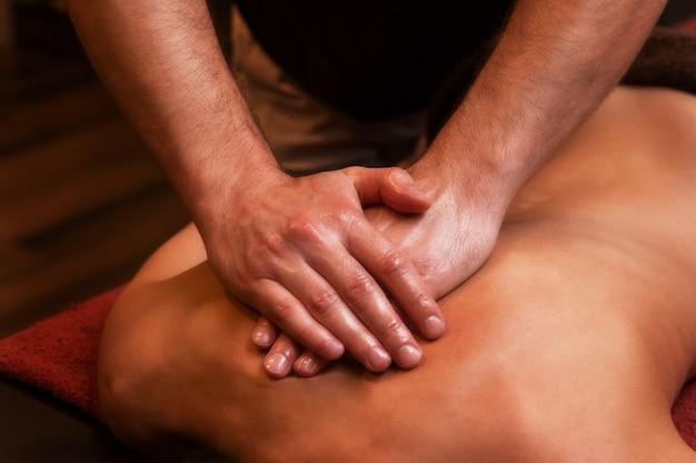 Back massage to woman
