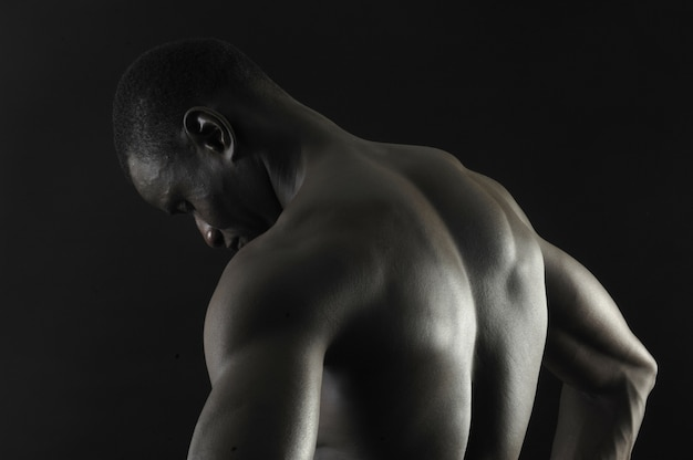 Back of a naked african boy,