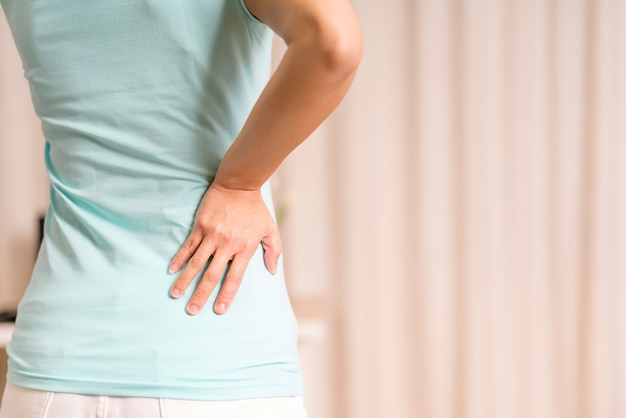 Back pain at home women suffer from backache healthcare and medical concept
