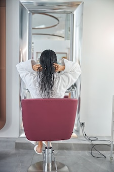 Back photo of a customer in a chair