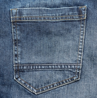 Back pocket of blue jeans, full frame, close up