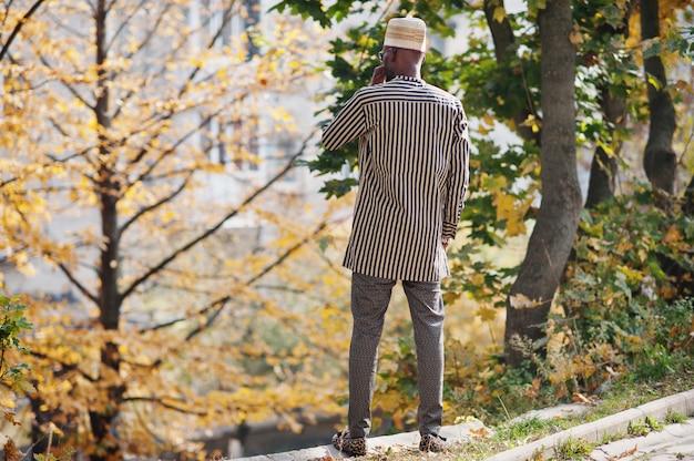 Back portrait of stylish man at hat