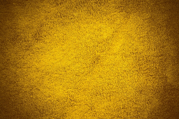 Back real golden leather textured background. Premium Photo