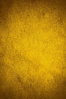 Back real golden leather textured background.