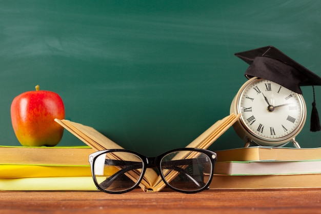 Back to school - apple and books with pencils and blackboard