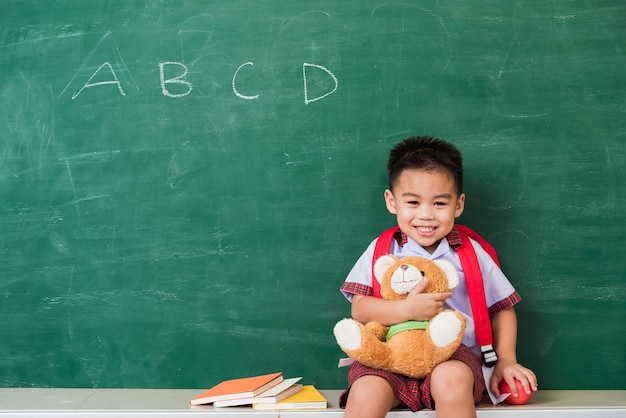 Back to school asian cute little boy from kindergarten in student uniform with school bag smiling