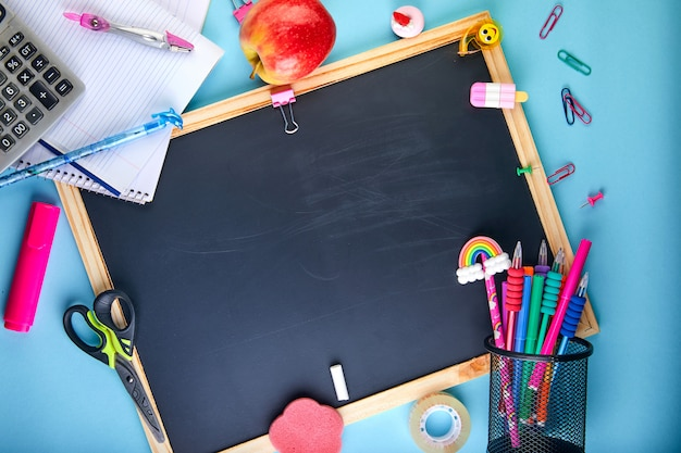 Back to school background with accessories for the schoolroom pencils, notebooks, books, scissors