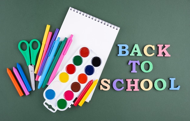Back to school background with colored pencils and notebook