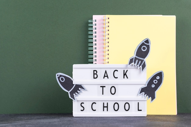 Back to school background with notebooks and light box
