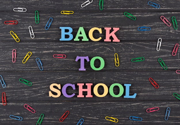 Back to school background with paperclips
