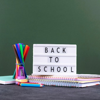 Back to school background with school supplies and light box