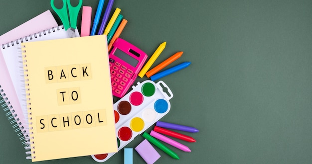 Back to school background with school supplies and notebook