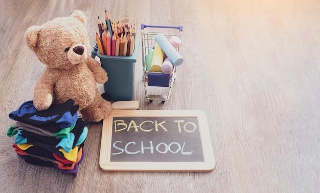 Back to school background with slate blackboard, pencils, chalks