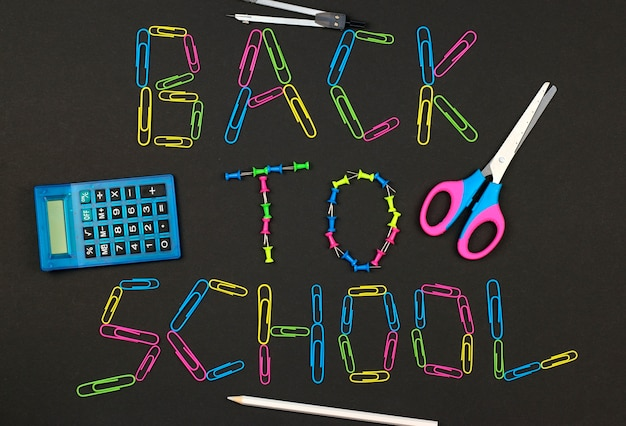 Back to school on the blackboard made of colorful paper clips