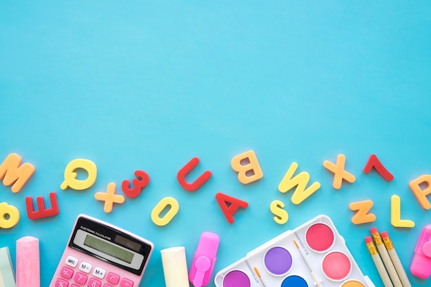 Back to school composition with letters and art elements