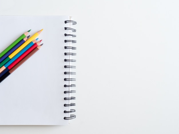 Back to school concept and artist kid concept with drawing book, crayons, coloured pencils, poster color and school stationery