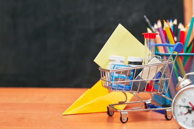 Back to school concept, basket with stationery on school board, university, college, copy space, close-up