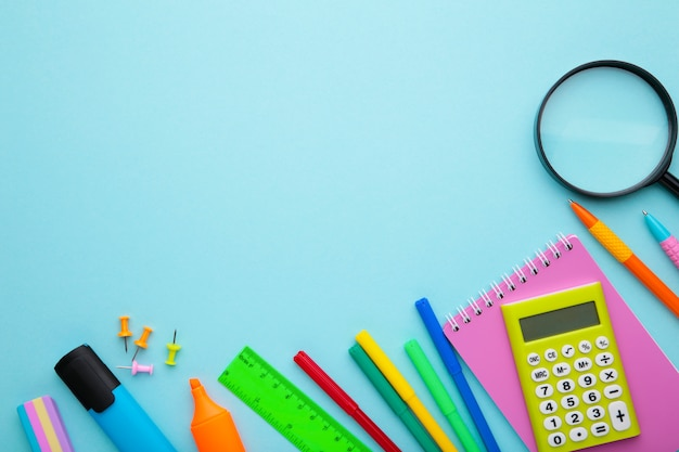 Back to school concept on blue background with copy space