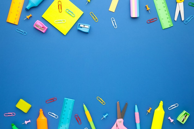 Back to school concept on blue wall. top view