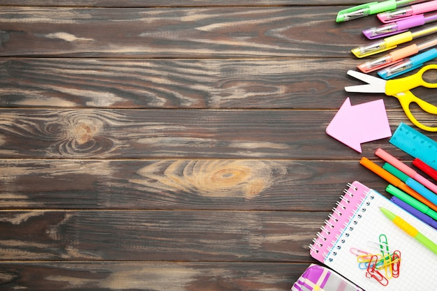 Back to school concept on brown wooden background. top view