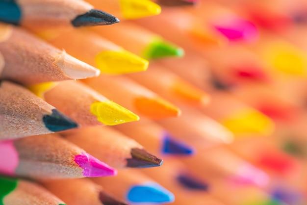 Back to school concept. close up macro shot of color pencil pile pencil nibs.