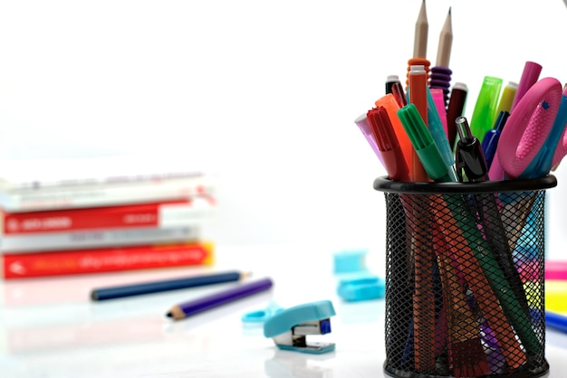 Back to school concept-close up of school supplies on a white background.