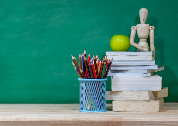 Back to school concept. colored pencil, and supplies  on wooden table